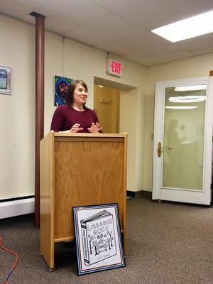 New Children's' Librarian Katie Senft spoke about the summer reading program at the annual meeting of the Lansing Community Library April 23. The following day, voters approved the 2019 library budget 118-1 (pending absentee ballots) and elected new trustees Jason Cole, Christine Eisenhut, and Maureen Cowan. Below Katie is the winning summer reading logo by Emma Hildreth.