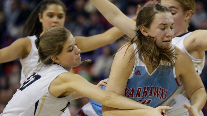 Appleton North's Anna Laux knocks the ball away from Arrowhead's Caitlyn Harper during the second half Friday night.