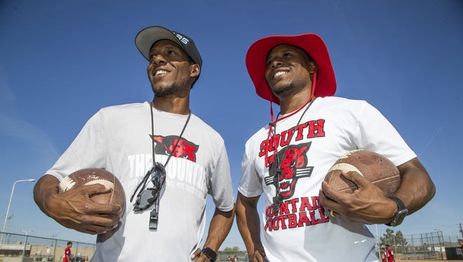 Mark and Marcus Carter are twin brothers who coach the South Mountain High School football team. They pose at practice at the school, Wednesday, April 25, 2018.