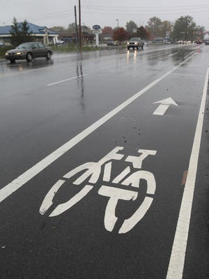 Bike lanes along 71st street in Indianapolis provide bicyclists with their own lane, rather than hindering traffic.  One reader is urging Pike Township to add more bike lanes.