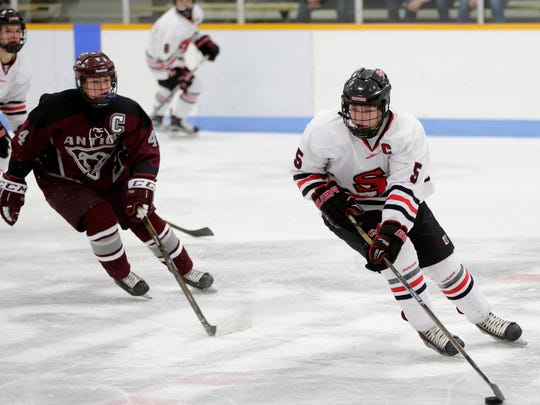 SPASH's Mark Stoskopf (5) carries the puck during the home opener against Antigo at the K. B. Willett Arena.