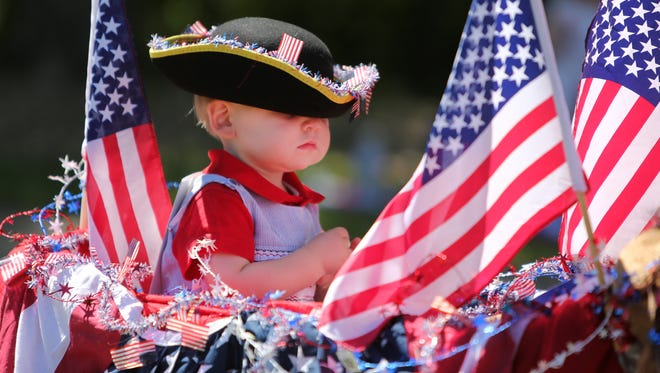 A children's bicycle parade will kick off the Independence Day festivities at Ault Park on Tuesday, July 4. Youngster Everett Patton was a participant in a previous year's parade.