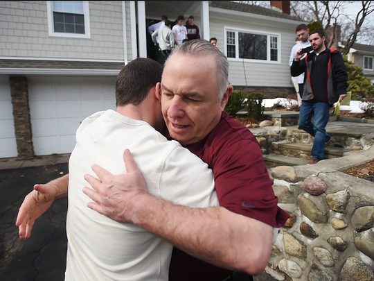 Don Bosco former coach Greg Toal receives a hug from one of his former players as  a group of current  Don Bosco Prep football players visit his home on Sunday morning as a show of support for their coach, who they feel was wrongly forced to resign by school officials. Photographed in Wyckoff on Feb. 19th, 2017.