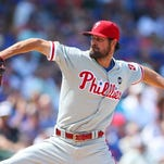 Jul 25, 2015; Chicago, IL, USA; Philadelphia Phillies starting pitcher Cole Hamels (35) throws a pitch during the first inning against the Chicago Cubs at Wrigley Field.