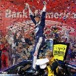 Brad Keselowski celebrates Saturday in victory lane after winning at Charlotte Motor Speedway.