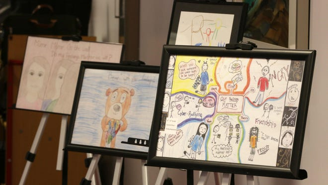 Children's drawings about mental health on display during USA TODAY NETWORK-Wisconsin's Kids in Crisis presentation March 9, 2016.