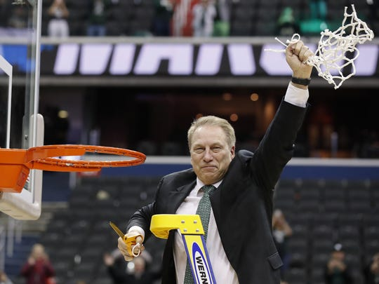 Michigan State head coach Tom Izzo holds up the net after defeating Duke in an NCAA men's East Regional final college basketball game in Washington, Sunday, March 31, 2019. Michigan State won 68-67. (AP Photo/Alex Brandon)