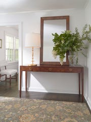ÒCorbusier said it best: Add furnishings and the entry becomes a room,Ó says decorator Lyn Peterson of Scarsdale. ÒAnd not just a walk through. MotifÕs rug traps dirt. Tribal rugs like this are great concealers. Nothing shows. Our Nicolai console replete with three clutter catcher drawers (think keys, receipts, sunglasses) welcomes all and presents a great opportunity for display.Ó