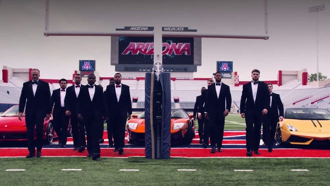 Rich Rodriguez is a secret agent in the latest video.