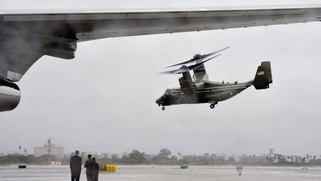 In this USA TODAY NETWORK file photo, a Marine Corps V-22 Osprey flies past Air Force One on the tarmac at Los Angeles International Airport. Four V-22 Osprey aircraft like the one pictured stopped in Evansville to refuel Thursday.