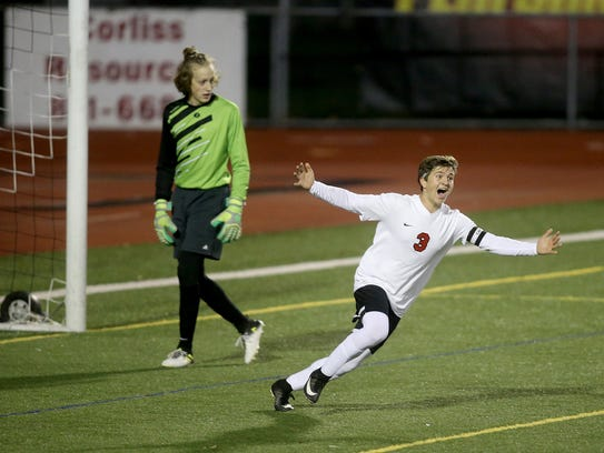 Crosspoint boys soccer player Aydan Laurion celebrates