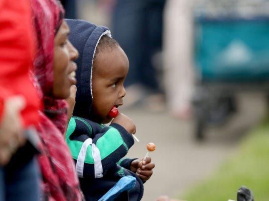 A child eats candy during the Keizer Iris Festival Parade on Saturday, May 21, 2016.