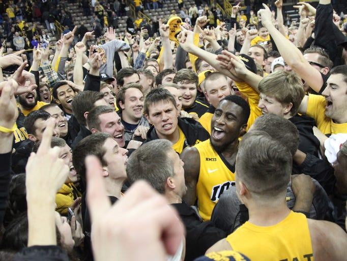 Iowa guard Anthony Clemmons celebrates with fans who