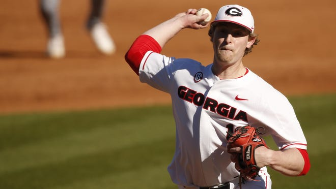 Georgia's Cole Wilcox (13) throws a pitch during a game against Massachusetts in Athens on March 7. Georgia won 16-2.
