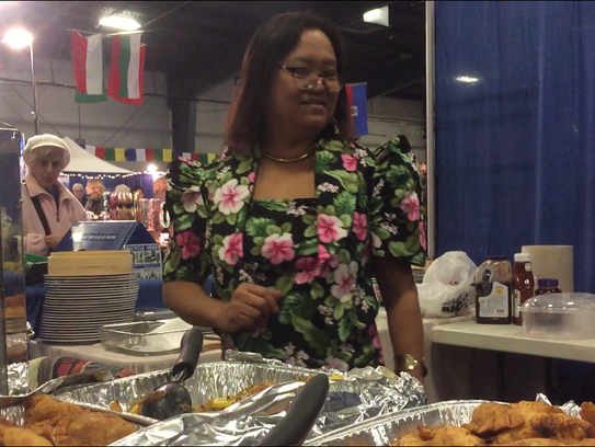 Elvira Golding of Charlotte serves up food from her
