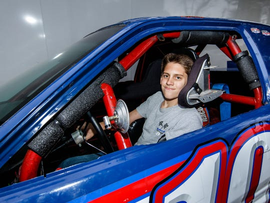 Ricky Gebhard, 13, poses for a photo in his race car.