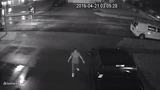 A still image from a video depicting people trying car doors near 68th Street and Dublin Avenue in Sioux Falls early Thursday morning.