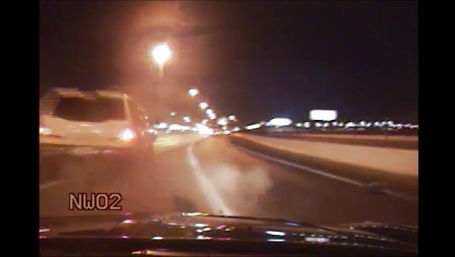 A still image from a Nevada Highway Patrol dash-cam video shows an SUV hit the patrol video. The driver was arrested on suspicion of driving under the influence of marijuana.