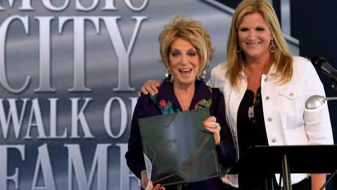 Jeannie Seely poses with Trisha Yearwood, who introduced her into the Music City Walk of Fame in Nashville on Tuesday, Aug. 21, 2018