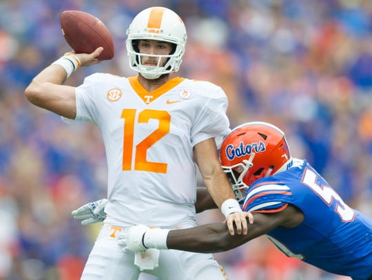 Vols quarterback Quinten Dormady (12) is sacked by