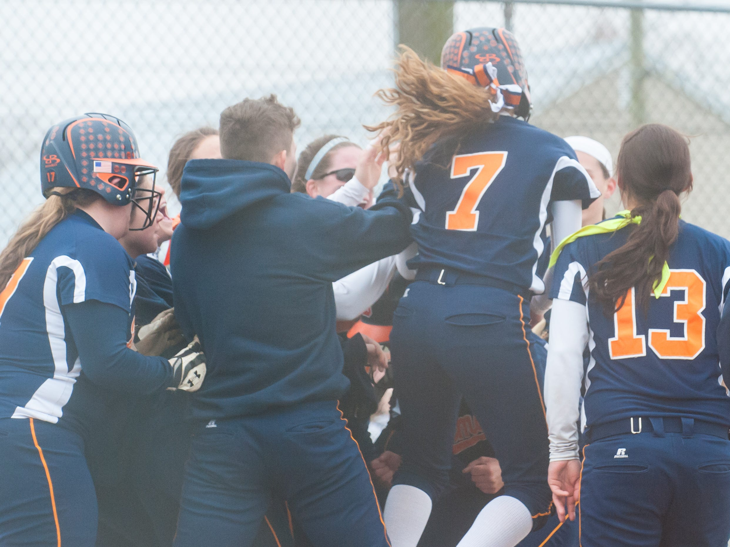 The Delmar softball team celebrates a home run by Shelby Murphy against Laurel at the Laurel Little League Complex on Thursday afternoon.