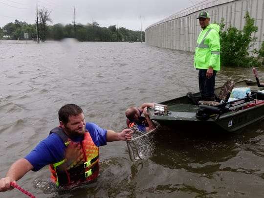 Acadiana residents rescued people trapped by Hurricane Harvey's flooding in the Houston area Aug. 28, 2017.