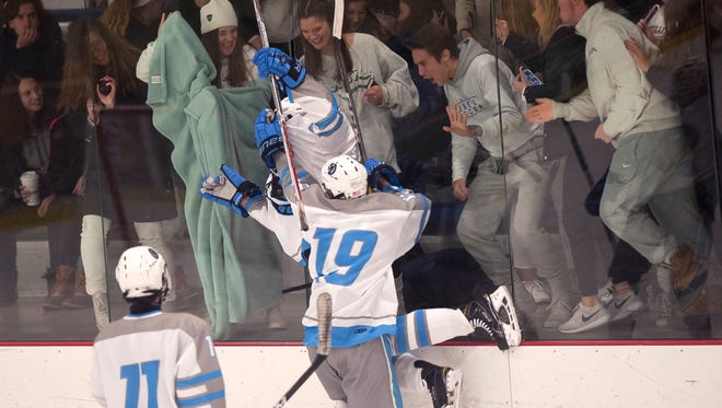 South Burlington players celebrate a goal in front of the student section during Saturday's CSB Cup boys hockey game at Cairns Arena in South Burlington.