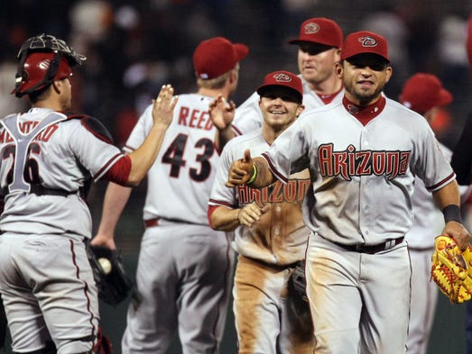 The Diamondbacks celebrate their 6-5 win in ten innings over the San Francisco Giants at AT&T Park.