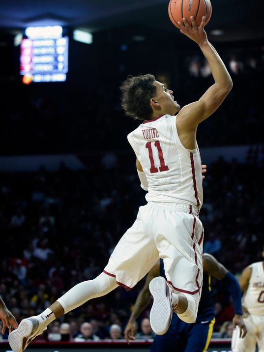 FILE - In this Feb. 5, 2018, file photo, Oklahoma's Trae Young goes up for a shot in the second half of an NCAA college basketball game against West Virginia, in Norman, Okla. Young spent many years dreaming of being like Blake Griffin, yet seemingly in the blink of an eye, he's heading into what could be his final home game Friday, March 2, 2018, against Iowa State. He's projected to be a first-round NBA draft pick, though the slender 6-foot-2 guard hasn't made a decision about his future.  (AP Photo/Kyle Phillips, File)