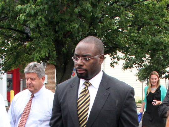 New Jersey Department of Community Affairs Commissioner Richard Constable III walks through Sea Bright with Mayor Dina Long in July 2013. Constable will be stepping down at the end of the month, according to Gov. Chris Christie's office.