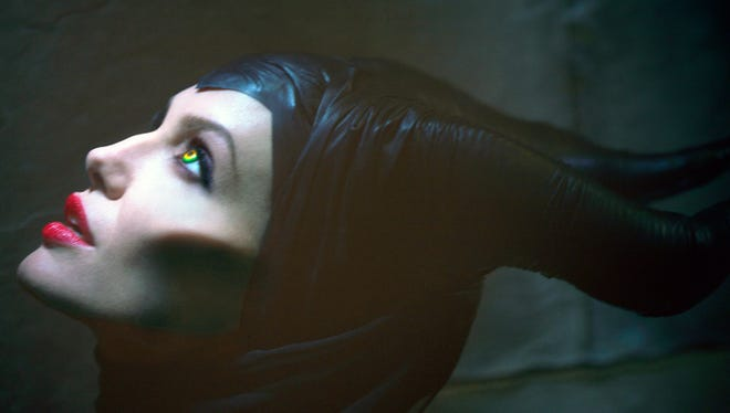 """Actress Angelina Jolie stars in the film """"Maleficent.""""  AP This image released by Disney Enterprises, Inc., shows actress Angelina Jolie in the title role of """"Maleficent,"""" the villian from the 1959 classic """"Sleeping Beauty.""""  (AP Photo/Disney Enterprises, Inc., Greg Williams)"""