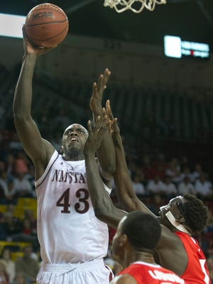 New Mexico State's Pascal Siakam takes a baseline jumper over New Mexico's Obji Aget during a game earlier this season at the Pan American Center.