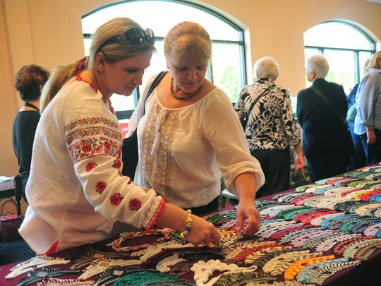 Irena Katerynyuk of Budd Lake looks at beaded jewelry made in Ukraine with her sister Lesiya Savehenko, who is visiting from Ukraine.