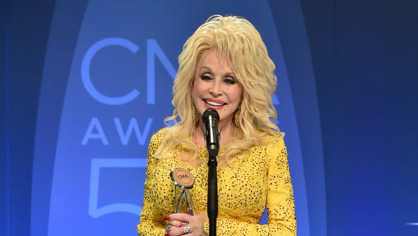 Dolly Parton poses in the press room with the Willie