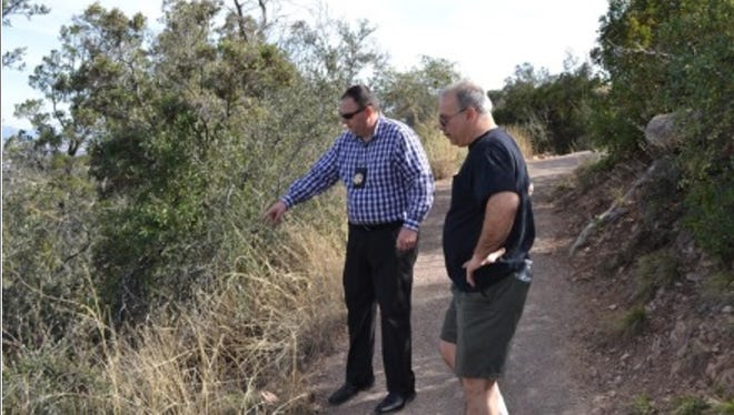 Catherine Sposito's brother, Sal, and Yavapai County Sheriff's Office Detective Ross Diskin visit the site of the crime in May 2016.