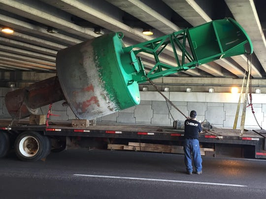 The buoy was damaged and large chunks of concrete fell onto the roadway. MDOT spokeswoman Jocelyn Hall says the damage appears to be cosmetic and not structural.