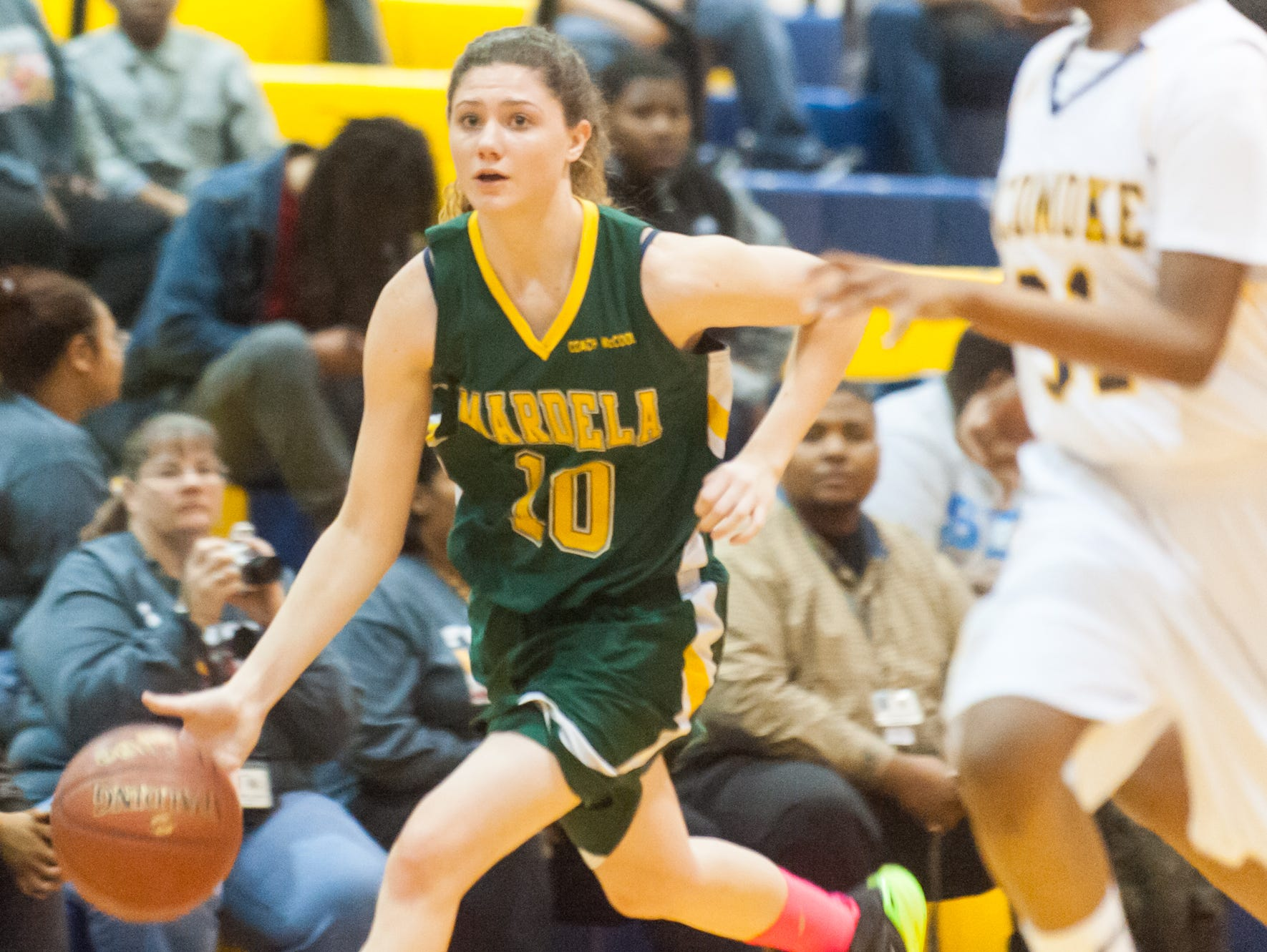 Mardela's Taylor Ross (10) works down court against Pocomoke at Pocomoke High on Thursday afternoon.