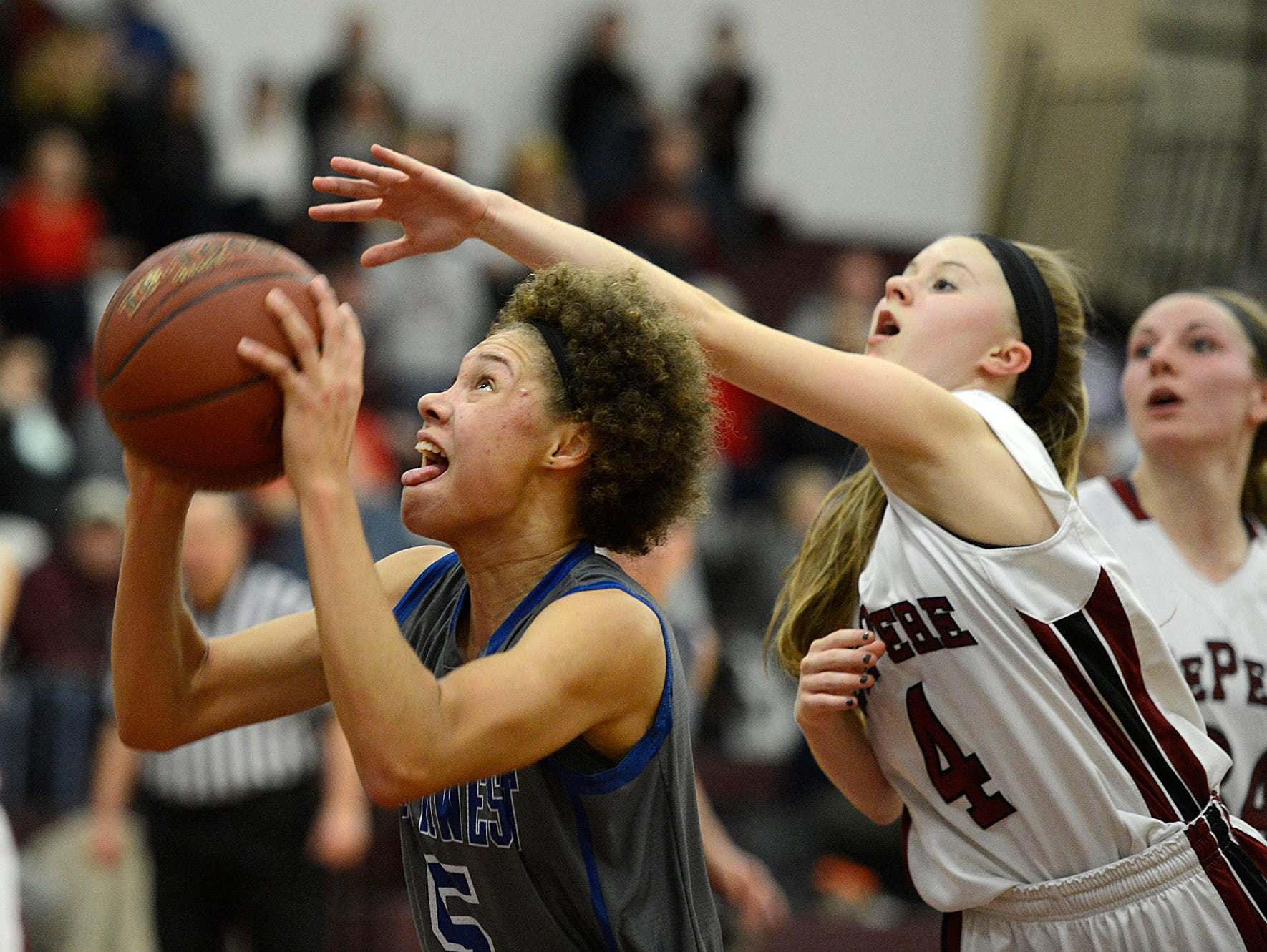 Green Bay Southwest's Natisha Hiedeman (5) drives to the basket past De Pere's Alexis Mashl (4) in the fourth quarter at De Pere High School.