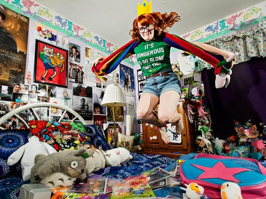 "Jessica Calhoun, 26, shows off her comic-themed bedroom at her home in West Des Moines. ""When you say 'This is silly, and this is childish,' it is also someone's artistic vision and someone's dream,"" said Calhoun. Her collections stem from a love for the ""Adventure Time"" comic series."