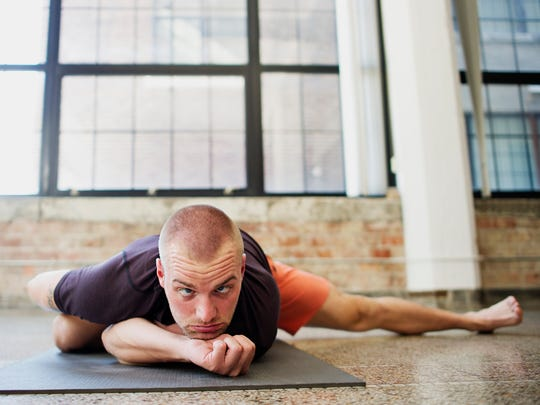 Mathew Koder, producer of the Iowa Yoga Festival, demonstrates