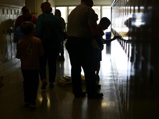 Students and parents fill the hallways during an open