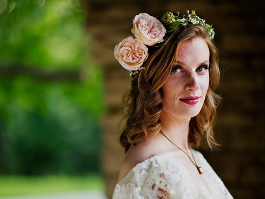 Abby Wolner, 25, models a Leona Ruby necklace and flower crown by The PeachPolkaDot.