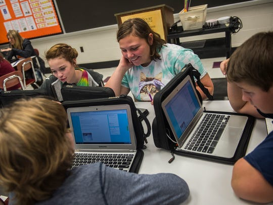 Students from Reagan Bitler's evolution of games class, from left, Erica Szwoyer, Jenna Buch, Ben Newman and Owen Smith, work on a project related to Viking history on Nov. 23, 2015.