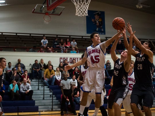 New Oxford's Justin Gruver battles for the ball against Shippensburg players on Dec. 14, 2015 in New Oxford.