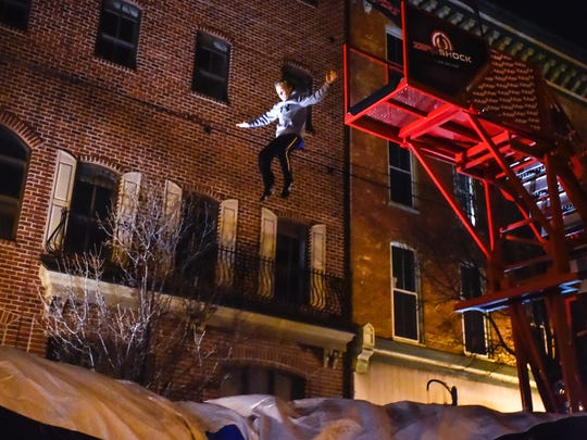 Connor Landrith, 11-years old, jumps off from Zero Shock in downtown Shippenburg, Pa on Dec. 31, 2015. Shippensburg dropped an anchor to ring in the New Years and had many othr festivities while families waited.