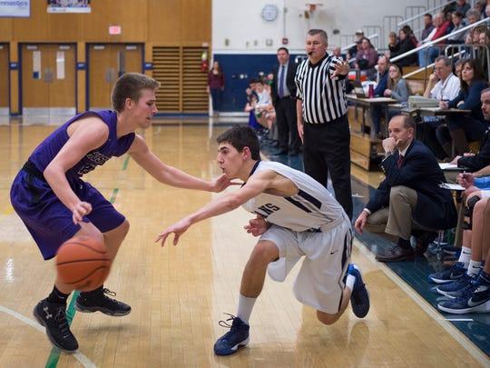 Chambersburg Trojan's Evan Shreffler passes the ball