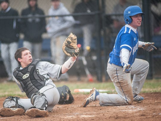 Spring Grove's Austin Piety reacts to the call after sliding home during a game last season.