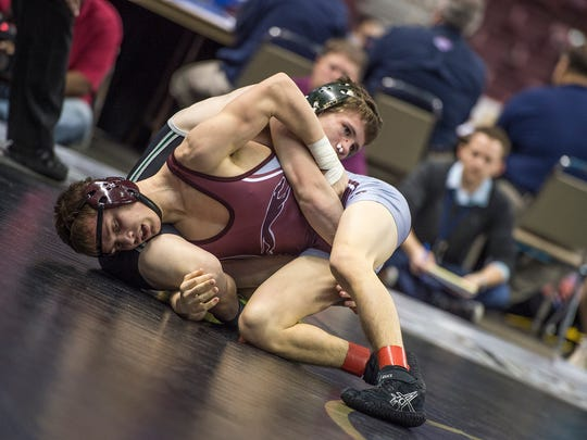 Shippensburg's Chandler Olson wrestles with Kordell Rush of Pennridge during the PIAA Wrestling Championships at Giant Center in Hershey, Pa. on Thursday, March 10, 2016. Olson defeated Rush 3-0.