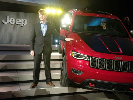 Head of Jeep Brand Mike Manley stands next to the 2017