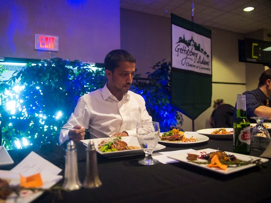 Judge Subarna Sijapati of the Adams County Farmers Market Association, assesses some plates in front of him during the Top Local Celebrity Chef Competition at Taste of the Town on Sunday at the Eisenhower Hotel & Conference Center in Gettysburg.